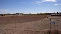 Fenced Graveled Industrial Yards