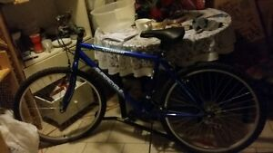 "Next to New 18"" male royal blue bike for sale"