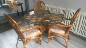 Glass top wicker table and 4 chairs