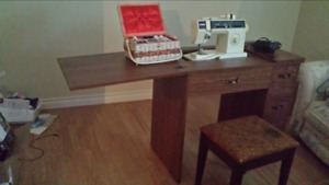 Sewing machine with convertible table