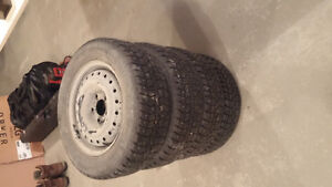 Studed winter tires with rims