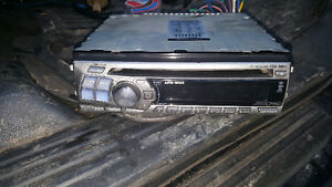 Alpine CDA 9827 AM/FM CD Player.  Single DIN  Front rear and sub