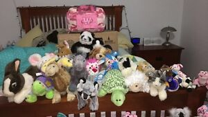 Webkinz with clothes outfits and 2 carry bags