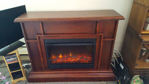 Solid Wood Electric Fireplace Great heat and Ambience $145 obo