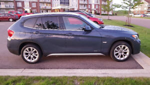 2012 BMW X1 x-Drive. Warranty included.  Priced to sell!