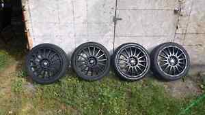($900 obo) 4 on 100 rims and tires