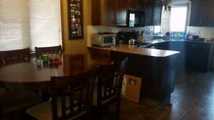 Furnished basement room. Bathroom. Wifi. Utilities. Garage Park