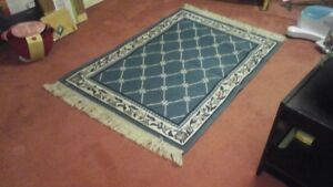"2 AREA RUGS ""LIKE NEW""      PRICE IS FIRM  $25 PER RUG"