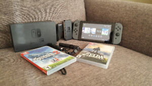 Nintendo Switch w/2 games & accessories 350$