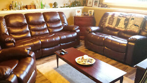 Leather recliner sofa, love seat, and chair