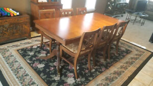 Solid wood dining room table w/2 leaf & 6 newly recovered chairs