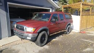 2003 Toyota Tacoma TRD with two sets of rims