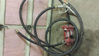 slip tidy tank pump and hoses and fuel nozzle