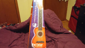 Childrens mini guitar London Ontario image 1