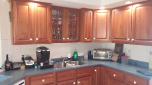 Kitchen and bathroom cherry cabinetry