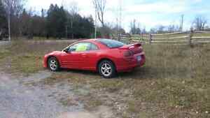 mitsubishi eclipse 2003 with 2 sets of tires on rims Peterborough Peterborough Area image 2