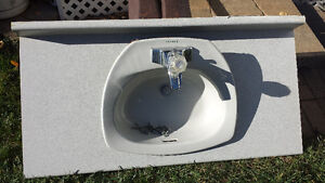 SINK WITH bathroom  COUNTER AND DELTA TAP