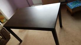 Dark wood effect dining table.