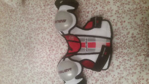 Hockey skates, helmet, shoulder pads,shin guards and gloves.