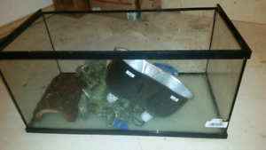 Large  45 gallon fish tank holds water.