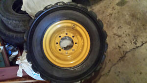CAT SKID STEER RIM & TIRE ONE ONLY