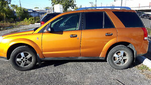 2006 Saturn VUE SUV with winter tires on rims. 4 cyl