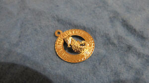 14 K. yellow gold charm/pendant seahorse from St. Maarten-1 gram West Island Greater Montréal image 1