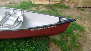 14' canoe for sale! Seats 3 and has a Built in cooler rod holder