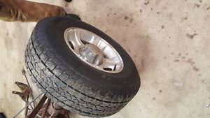 4 Ford ranger rims and tires with center caps.