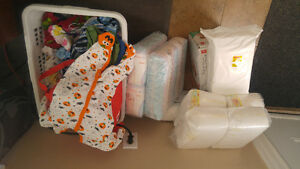 Assorted Boys and Girls Sleepers for sale and Huggies Diappers