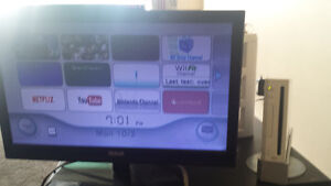 """Wii console and 20"""" screen + games/fitness stuff"""