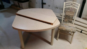 Dining table with leaf and 4 dining chairs.