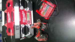 Milwaukee Radio and 1 Drill, battery, charger.