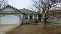 Immediate Possession Lacombe home backing onto tot lot