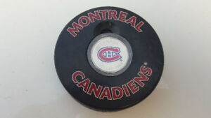 Montreal Canadians collector puck with coin.