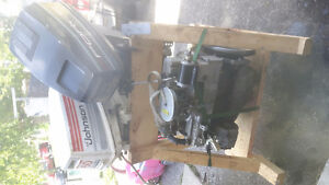 2 outboards and 1 inboard boat motor