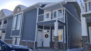 PRICED TO SELL!  Condo with Balcony & Single detached garage