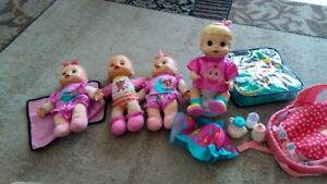 FOUR BABY ALIVE DOLLS AND SOME ACCESSORIES...INCLUDED