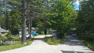 2 Houses plus a motel on 6 acres waterfront