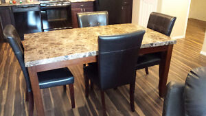 Faux marble dinning room table and chairs