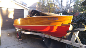 Wooden boat, 20 hp mercruiser motor and trailer