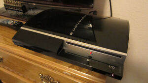 PS3 Playstation with 2 controllers and some games and movies
