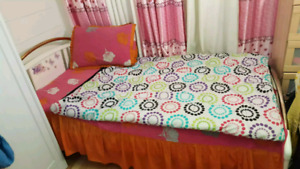 Twin bed with mattress and wardrobe
