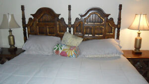 King size bed with headboard and tables