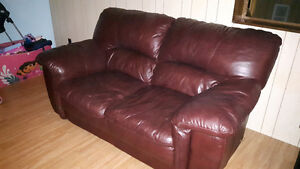 Leather burgundy love seat and leather green chair