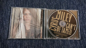 MYLEY CYRUS - CAN'T BE TAMED ---- $5!!!