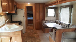 36 ft RV and Golf Cart on lovely lot at Great Canadian Hideaway.