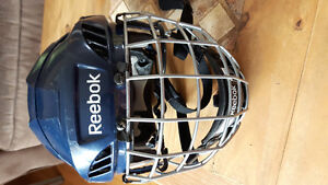 Hockey helmet with cage.