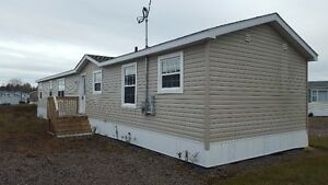 Newer Mini Home on own lot in Truro,