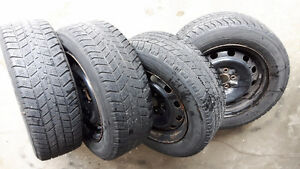 3 Used snow tires with 4 x15 inches steel rims Kitchener / Waterloo Kitchener Area image 1